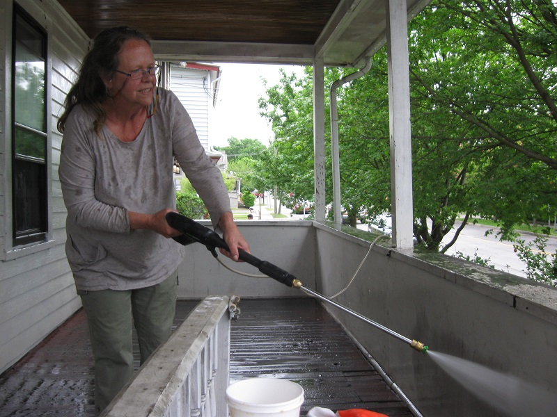 Deb power washing porch 5/20/17